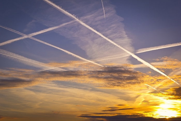 airplane contrails at sunset