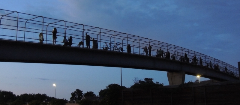 people say good-bye to the 24th St pedestrian bridge over 35W