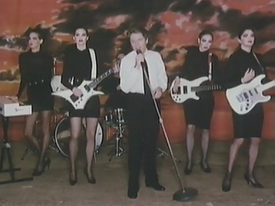 Robert Palmer and models play Addicted To Love in 1986